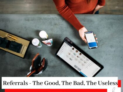 Person in a red jumper with a phone and a laptop on a grey table with the title Referrals - The Good, The Bad, The Useless