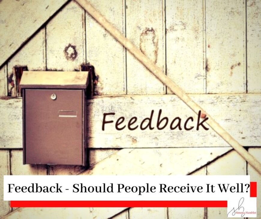A wooden door with the wooden post box and the word feedback written next to it, with the title Feedback - Should People Receive It Well?