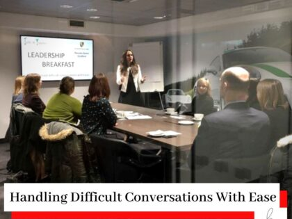 Photo of Simona Hamblet presenting at a leadership event on Handling Difficult Conversations With Ease