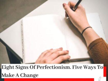 Person writing in a blank book on a desk wearing a brown jumper with the title Eight Signs Of Perfectionism - Five Ways To Make A Change