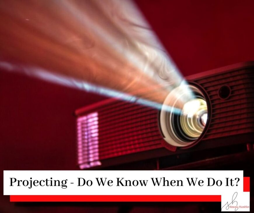 Film projector projecting a beam of light in the dark with the title Projecting - Do We Know When We Do It?